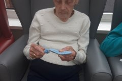 Making Pom Poms at care home in Hyde