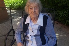 Sitting in the sunshine in the garden at nursing home in Hyde