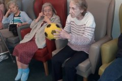 Playing softball at nursing home in Hyde