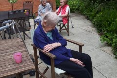 Residents in the sunshine at Charnley House care home in Hyde
