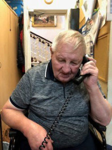 care home Chesterfield John on phone