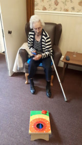 Residents playing the bean bag game at Chesterfield care home