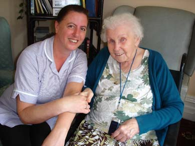 Charnley house nursing care home Hyde bedroom carer and resident