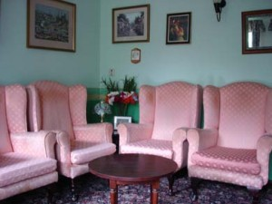 Charnley house nursing care home Hyde painting the lounge